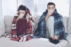 couple-is-sitting-couch-wrapped-blankets_85574-9828